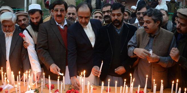 PAT leadership joins candle vigil in memory of children martyred in Peshawar