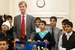 Boys from Minhaj Art School gift a painting to British MP