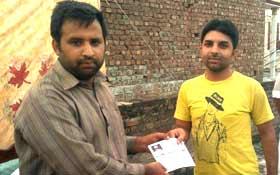 آڈھا: تحریک منہاج القرآن کے زیراہتمام غریب افراد میں راشن کی تقسیم