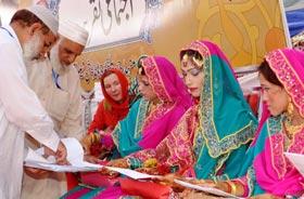 فیصل آباد: منہاج ویلفیئر فاؤنڈیشن کے زیراہتمام اجتماعی شادیوں کی پروقار تقریب
