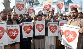 تحریک منہاج القرآن کے تحت توہین آمیز خاکوں کی اشاعت کے خلاف احتجاجی ریلی