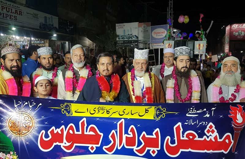 منہاج القرآن لاہور کے زیراہتمام واہگہ ٹاون اور شالیمار ٹاون میں مشعل بردار جلوس