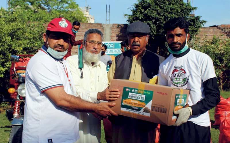 گجرات: منہاج ویلفیئر فاؤنڈیشن کی جانب سے سیکڑوں مستحق گھرانوں میں راشن پیکجز کی تقسیم