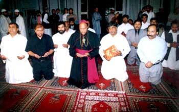 A Christian delegation prays at Minhaj-ul-Quran mosque (Masjid)